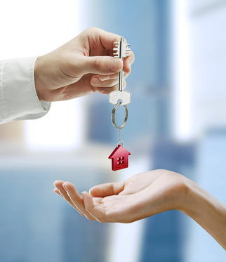 Man is handing a house key to a woman